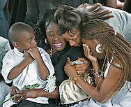 Pallbearers carry the body of Ronnie Holmes. He died from multiple gunshot wounds from a drive by shooting. on April 10, 2007. He was one Umoja Village Shantytown's first residents. Here, Ronnie's sister, Nicole Holmes-Labroche is comforted by Patricia Hodge and Ronnies niece, Kharisma Labroche. at left is his nephew Pierre Labroche Jr. at interment services at Dade Memorial Park North.