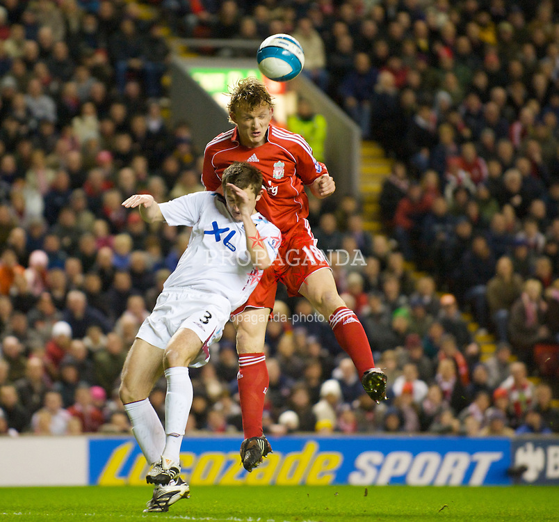 LIVERPOOL, ENGLAND - Wednesday, March 5, 2008: Liverpool's Dirk Kuyt and West Ham United's George McCartney during the Premiership match at Anfield. (Photo by David Rawcliffe/Propaganda)