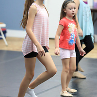 Faith Williams, 11, of Tupelo, follows the lead of Alissa La Vergne, a Radio City Rockette, as she teaches a dance routine to a group of Tupelo girls at the North Mississippi Dance Centre's dance camp.