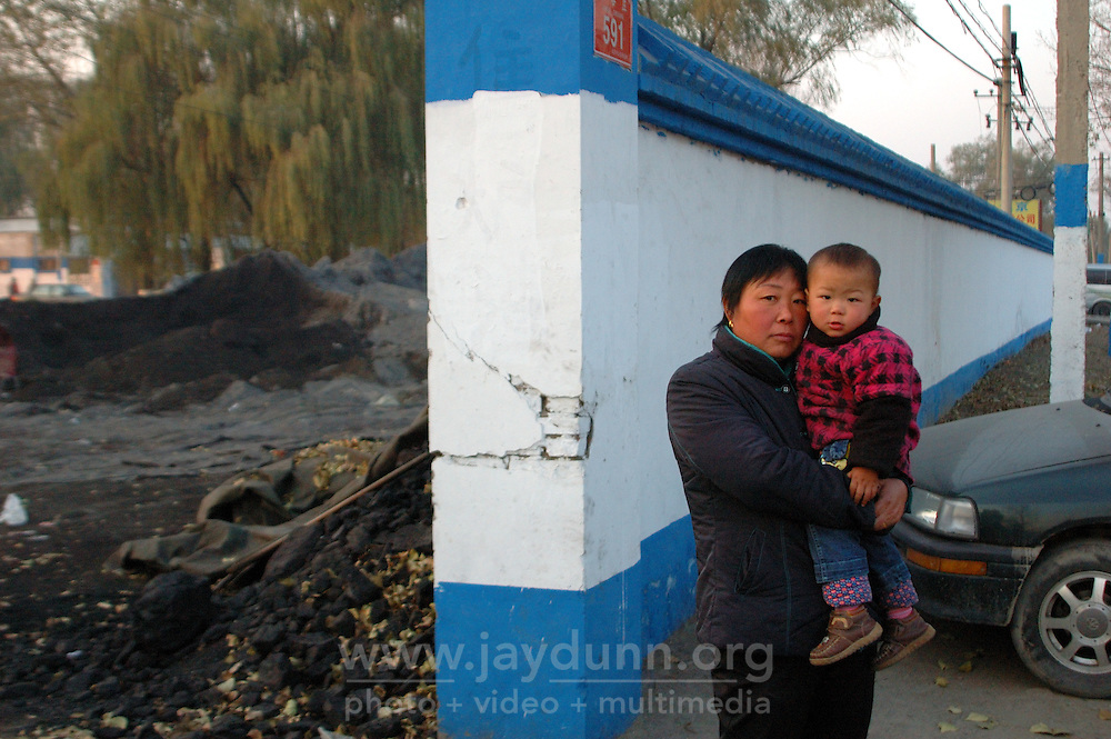 China, Beijing, Ping Fang Xiang, 2008. On the north side of Chao Yang Bei Lu outside the 5th Ring Road, economic progress has been slow to come to these residents..