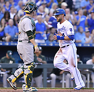 April 13, 2017 - Kansas City, MO, USA - The Kansas City Royals' Alex Gordon, right, scores in front of Oakland Athletics catcher Stephen Vogt on a single by Lorenzo Cain in the first inning at Kauffman Stadium in Kansas City, Mo., on Thursday, April 13, 2017. (Credit Image: © John Sleezer/TNS via ZUMA Wire)
