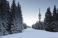 Radio tower around a ski slope