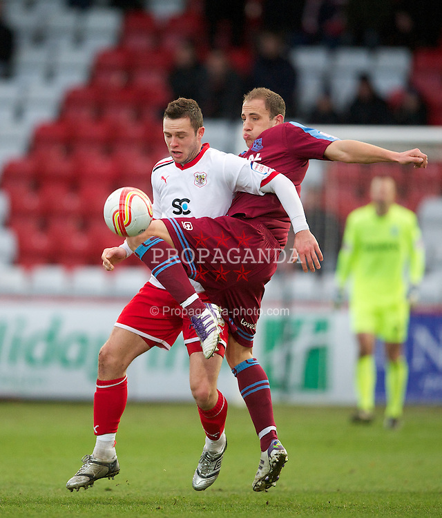 STEVENAGE, ENGLAND - Saturday, December 17, 2011: Tranmere Rovers' Mark McChrystal in action against Stevenage's Chris Beardsley during the Football League One match at Broadhall Way. (Pic by David Rawcliffe/Propaganda)