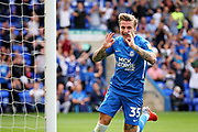 Peterborough United forward Jason Cummings (35) celebrates his first goal during the EFL Sky Bet League 1 match between Peterborough United and Luton Town at London Road, Peterborough, England on 18 August 2018.