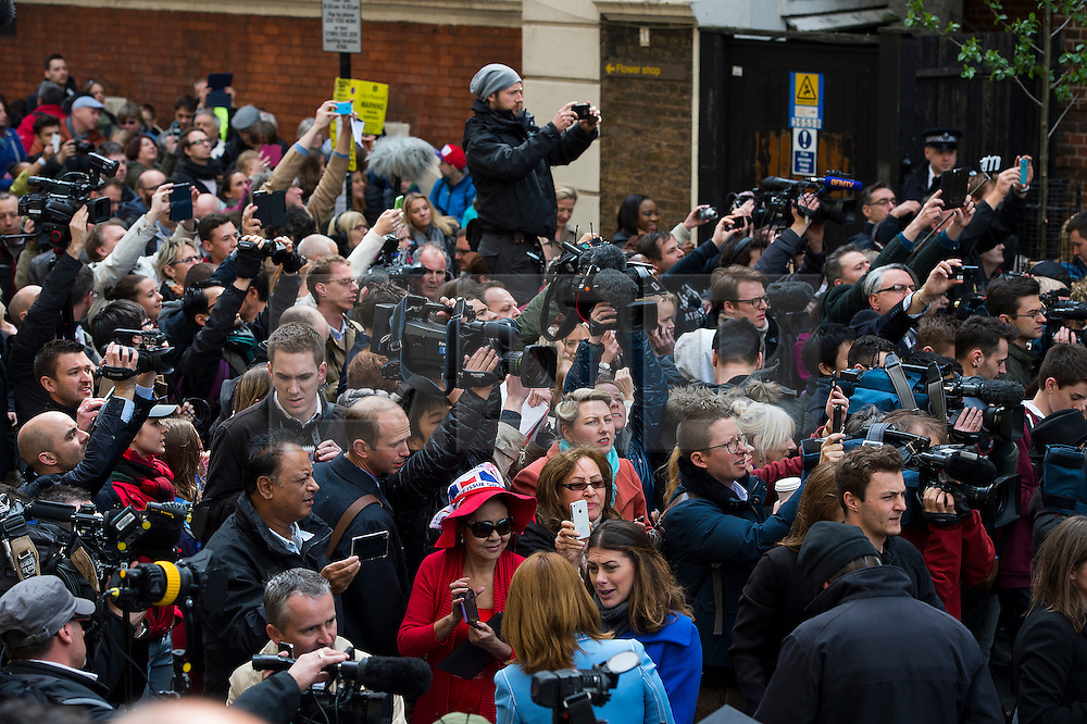 © London News Pictures. 02/05/2015. media and fans outside the Lindo Wing of St Mary's Hospital watch Catherine Duchess of Cambridge and Prince William leave the Lindo Wing of St Mary's hospital in London holding their new born baby daughter, Princess of Cambridge. Photo credit: Ben Cawthra /LNP