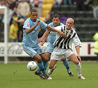Photo: Leigh Quinnell.<br /> Notts County v Bury. Coca Cola League 2. 06/05/2006.<br /> Burys Dwayne Mattis brushes Notts Countys David Pipe aside.