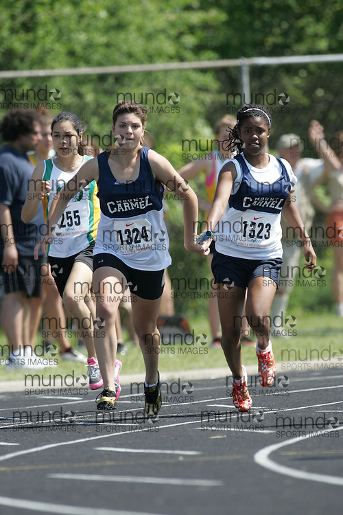 Hamilton, Ontario ---06/06/08--- Stephanie Davis of Our Lady of Mount CarmelinMissi competes in the 4X100 meter relay at the 2008 OFSAA Track and Field meet in Hamilton, Ontario..SEAN BURGES