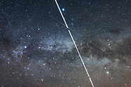 The International Space Station &ndash; the bright streak &ndash; shoots across the Milky Way amid the Summer Triangle stars on May 29, 2017 during one of its several passes this night. Other fainter satellite trails are also visible. Vega is at top, Deneb at left, Altair at right &mdash; the three stars of the Summer Triangle. <br /> <br /> This is a stack of 3 x 1-minute exposures with the 35mm lens at f/2.2 and Canon 6D at ISO 1250, with the camera on the Star Adventurer Mini tracker. High haze added the natural star glows &ndash; no filter was employed. The trail gaps are from the 1 second interval between exposures.