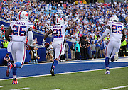 Leodis McKelvin, center, celebrates an interception in the closing moments of a game against the Miami Dolphins in Buffalo, New York on September 14, 2014.