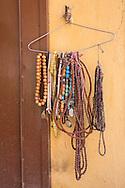 Necklaces on a hanger near Bodnath Stupa, Kathmandu.