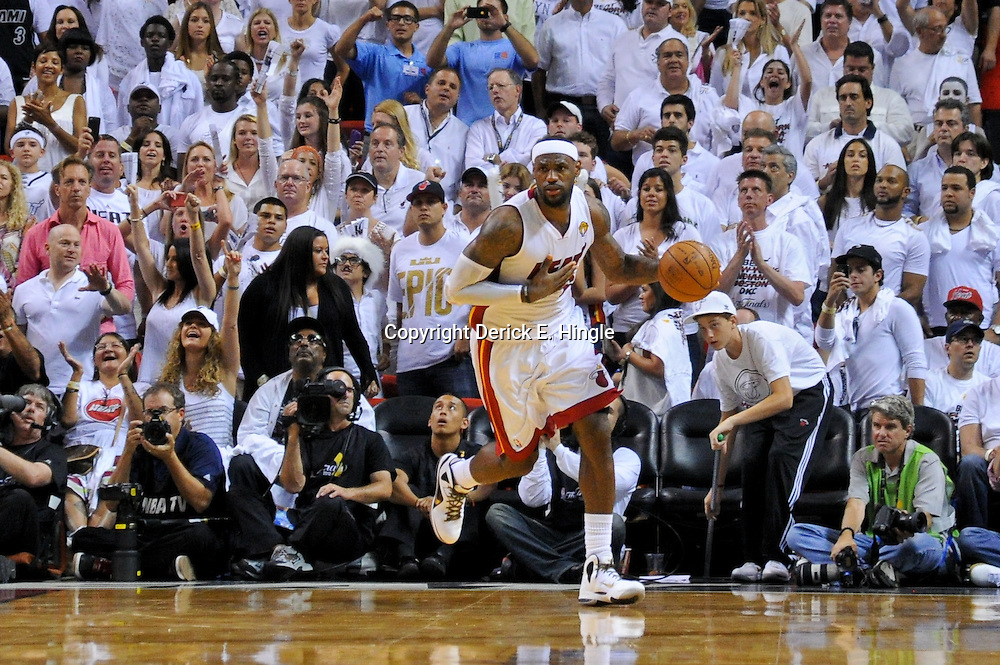 Jun 17, 2012; Miam, FL, USA; Miami Heat small forward LeBron James (6) against the Oklahoma City Thunder during the fourth quarter in game three in the 2012 NBA Finals at the American Airlines Arena. Miami won 91-85. Mandatory Credit: Derick E. Hingle-US PRESSWIRE