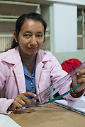 "María taking part in a textile workshop.<br /> <br /> Maria is originally from Paraguay and has been in Brazil for six years. <br /> <br /> She is studying, ""for the chance for a better tomorrow, to be someone in life and provide more for our children. """