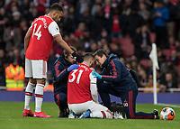 Football - 2019 / 2020 Premier League - Arsenal vs. Everton<br /> <br /> Pierre-Emerick Aubameyang (Arsenal FC) consoles team mate Sead Kolasinac (Arsenal FC) after he injures his shoulder at The Emirates Stadium.<br /> <br /> COLORSPORT/DANIEL BEARHAM
