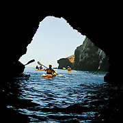Volcanic sea caves honeycomb the shoreline of Santa Cruz Island, Channel Islands National Park, CA..From within the Dogleg cave.