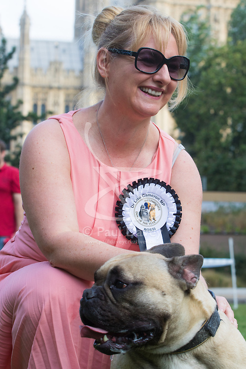 MPs and members of the House of Lords bring their pooches to Parliament as they compete to be crowned The Dogs' Trust and The Kennel Club's Westminster Dog Of The Year. PICTURED: Dr Lisa Cameron MP (SNP) East Kilbride, Strathaven and Lesmahagow and her French Bulldog Rossi