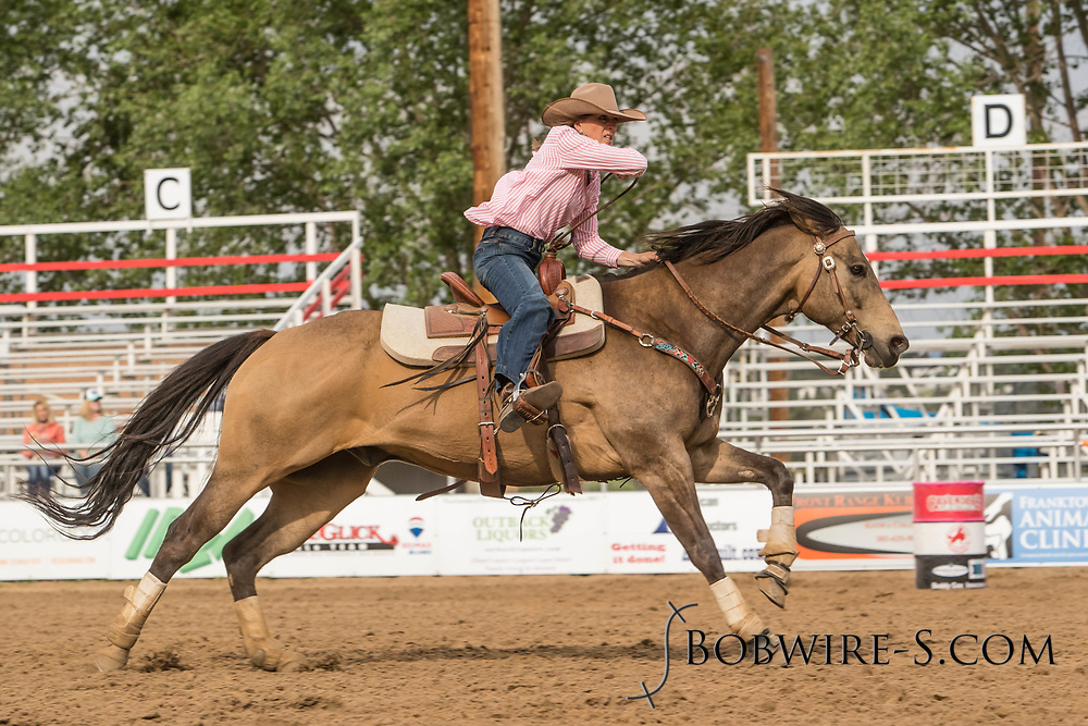 Bonnie Wheatley makes her barrel racing run during slack at the Elizabeth Stampede on Sunday, June 3, 2018.