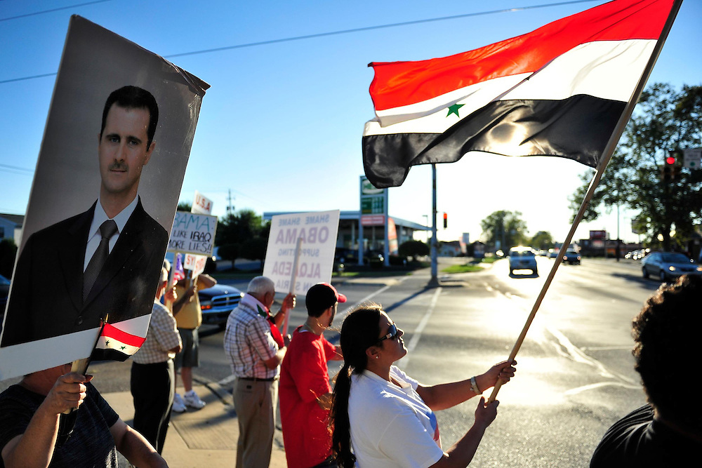 Syrian Americans protest against US involvement in Syrian Civil War. Members of the local Syrian community rally for the second week against the United States involvement in Syria, Thursday, September 5, 2013 in Allentown, PA.