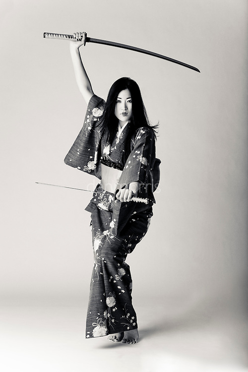 Sexy Japanese woman poses in kimono with katana, anime style