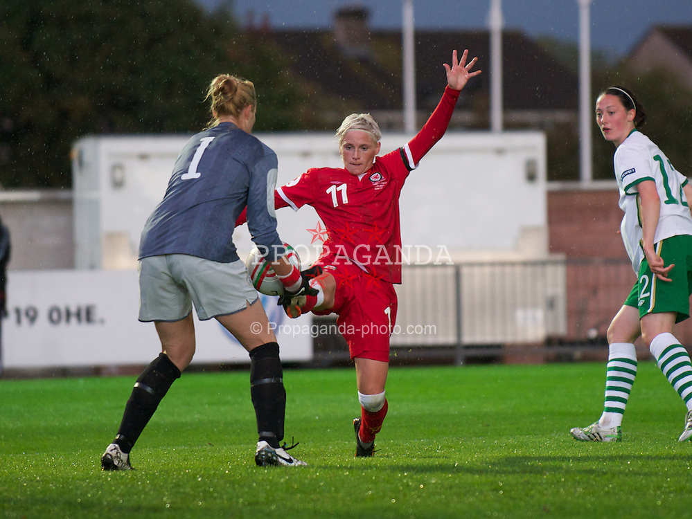 NEWPORT, WALES - Saturday, September 17, 2011: Wales' Jessica Fishlock (Bristol Academy) in action against the Republic of Ireland's goalkeeper Emma Byrne (Arsenal) during the UEFA European Women's Championship 2011-13 Group 4 Qualifying match at the Newport Stadium. (Pic by David Rawcliffe/Propaganda)