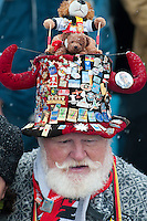 A fan from Cologne, Germany, wears a hat with horns covered in Olympic pins to a biathlon competition during the 2010 Olympic Winter Games in Whistler, BC Canada.