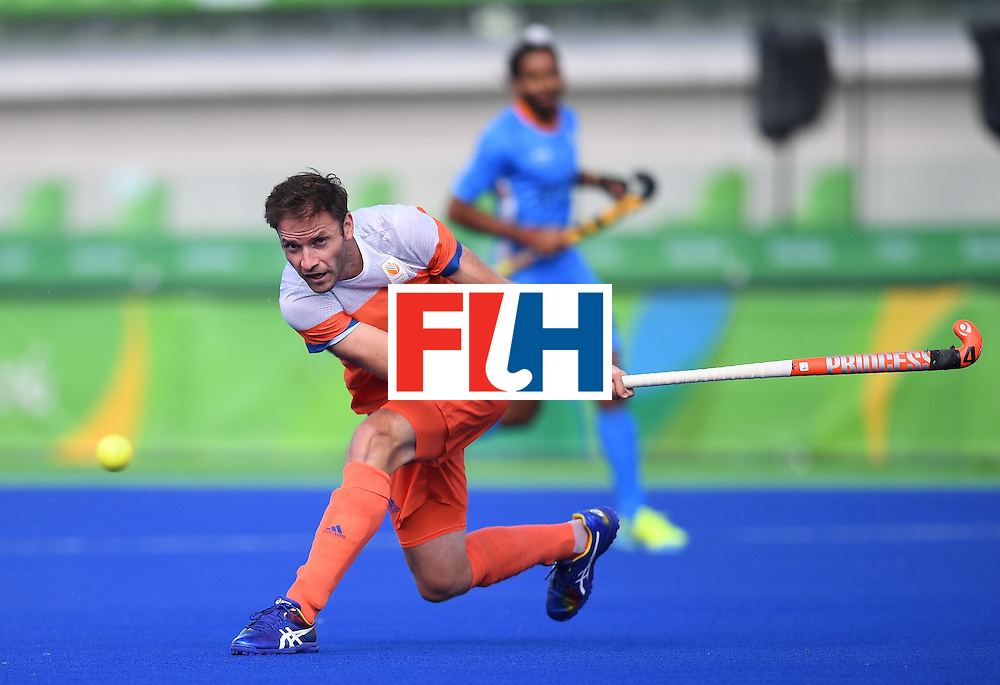 Netherland's Rogier Hofman hits the ball during the men's field hockey Netherland's vs India match of the Rio 2016 Olympics Games at the Olympic Hockey Centre in Rio de Janeiro on August, 11 2016. / AFP / MANAN VATSYAYANA        (Photo credit should read MANAN VATSYAYANA/AFP/Getty Images)
