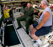 7/30/06 LaVista. NE 11-year-old Alex Epperson listens to  Matt M. Boring  (center) and Gary Roth talk about the Light Armored Vehicle they were sitting in that was on display at LaVista?s Night Out event at Central Park Sunday evening.  The vehicle was on display by the Nebraska Counter Dug Task Force.