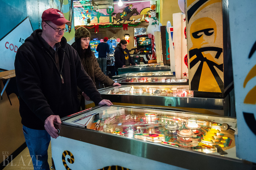 Rod Winzinek and Michelle McCleester both of Canton play pinball at the Super Electric Pinball Parlor in the Ohio City neighborhood of Cleveland.