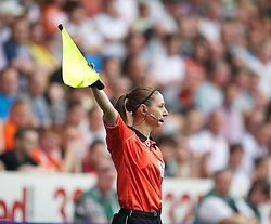 SWANSEA, WALES - Sunday, October 2, 2011: Female assistant referee Sian Massey runs the line during the Premiership match between Swansea City and Stoke City at the Liberty Stadium. (Pic by David Rawcliffe/Propaganda)