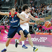 02 August 2012: Spain Sergio Llull vies for the loose ball with Great Britain Andrew Lawrence during 79-78 Team Spain victory over Team Great Britain, during the men's basketball preliminary, at the Basketball Arena, in London, Great Britain.