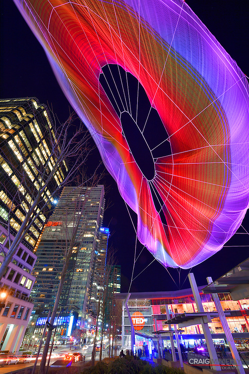 UnNumbered Sparks interactive sculpture, created by Janet Echelman, floats over night sky of downtown Vancouver during Ted Talks 2014.