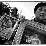 """Relatives of those killed during clashes with Thai security forces gather Saturday, May 19, 2012 on the second anniversary of the riots in the Thai capital.   At least 92 people were killed during the clashes between supporters of the """"Red Shirts"""" and security forces."""