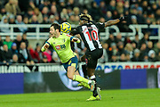 Allan Saint-Maximin (#10) of Newcastle United fouls Adam Smith (#15) of AFC Bournemouth during the Premier League match between Newcastle United and Bournemouth at St. James's Park, Newcastle, England on 9 November 2019.