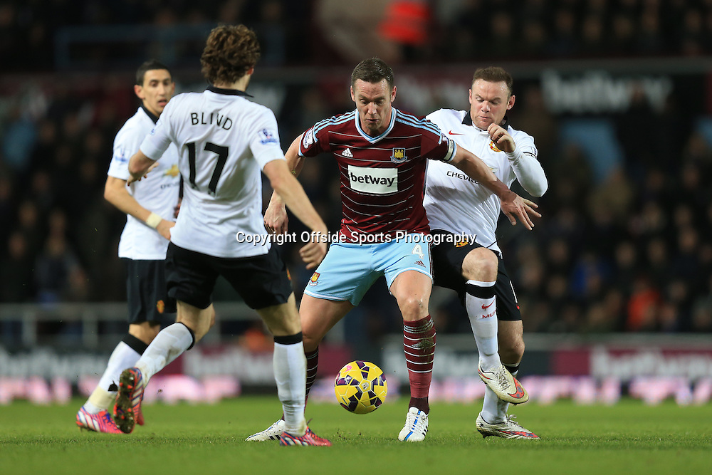 8 February 2015 - Barclays Premier League - West Ham United v Manchester United - Kevin Nolan of West Ham takes on Wayne Rooney and Daly Blind of Manchester United - Photo: Marc Atkins / Offside.