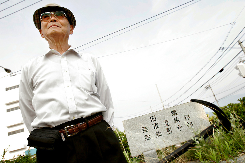 Hiroshima A-Bomb survivor - Trained to be a sea kamikaze. Photo: in front of a monument for the Japanese navy of the IIWW, in an abandoned memorial park. nIt is near the spot at the old port, where he arrived with his boat at the 6th August 1946, after the bombing.
