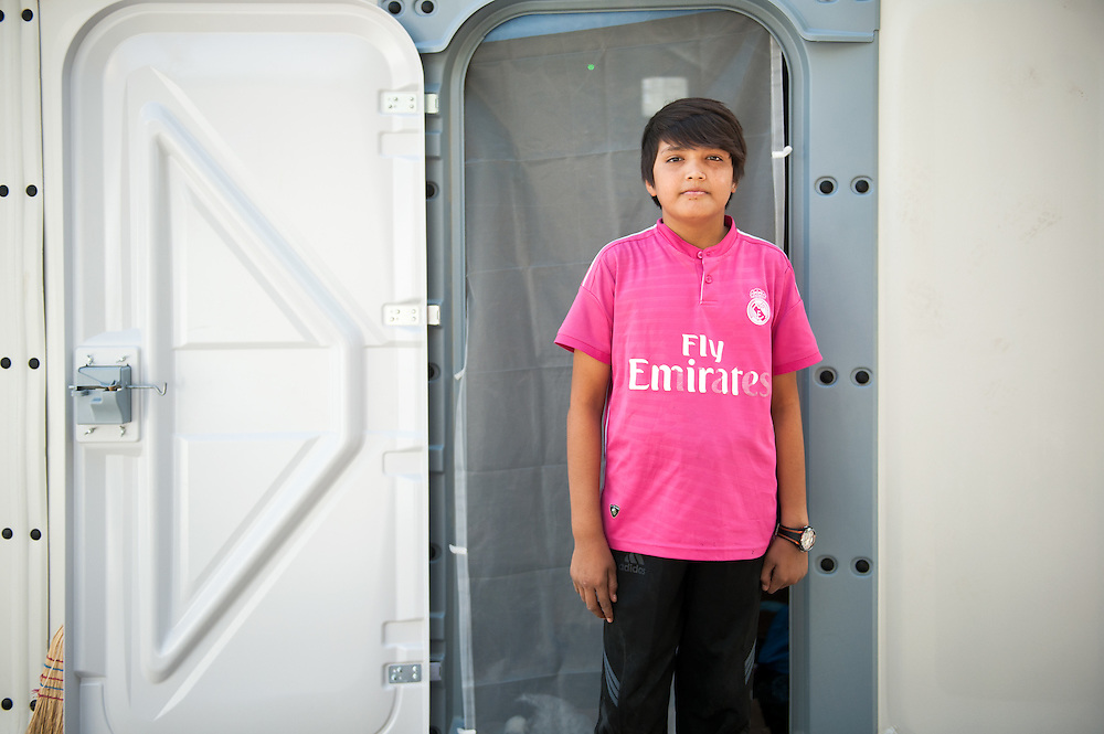 Abulfaz 11 years old, from Teheran, Iran, outside his tent at Moria camp, Lesvos, Greece.