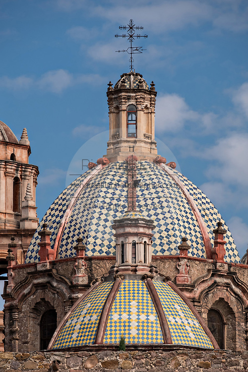 The tiled domes of the San Francisco Convent and the Aranzazu Chapel in the Plaza de Aranzazu in the state capital of San Luis Potosi, Mexico. The chapel and convent was built between 1749 and 1760 and features Churrigueresque details and tiled domes.
