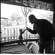 Digby plays with Tony Blair, a monkey at the Mi Thuna Guesthouse on Hwy 8 in Na Hin, Laos.....