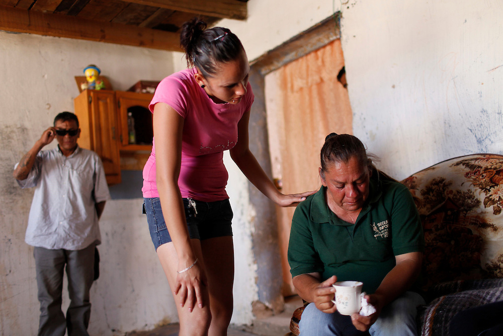 From left, Antonio Guajardo, friend, Erica Guereca cousin, and Maria Guadalupe Hernandez mourn the death Sergio Adrian Hernandez Guereca, who was killed yesterday by a Border Patrol agent, (the family is shown in the house of his mother on June 8, 2010 in Ciudad Juarez.)