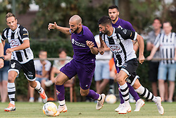 (L-R) Riccardo Saponara of ACF Fiorentina, Mohammed Osman of Heracles Almelo during the Pre-season Friendly match between Heracles Almelo and Fiorentina at Sportpark Wiesel  on August 01, 2018 in Wenum-Wiesel , The Netherlands