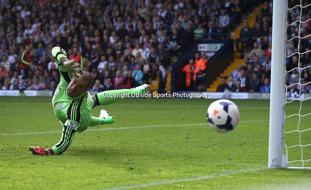 6th October 2013 - Barclays Premier League - West Bromwich Albion v Arsenal - West Brom goalkeeper Boaz Myhill dives - Photo: Simon Stacpoole / Offside.