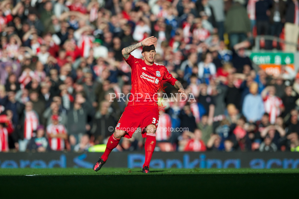 LIVERPOOL, ENGLAND - Sunday March 18, 2012: Liverpool's Martin Skrtel shields his eyes from the sun during the FA Cup Quarter-Final match against Stoke City at Anfield. (Pic by David Rawcliffe/Propaganda)