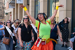 Edinburgh, Scotland, UK. 3 August 2019. On the first weekend of the Edinburgh Fringe Festival good weather brought out thousands of tourists to enjoy the many street performers  on the Royal Mile in Edinburgh Old Town. Pictured Silent disco. Iain Masterton/Alamy Live News