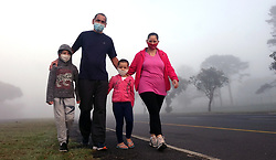 South Africa - Cape Town - 010520.  Eugene Johannes, wife Joanne, daughter Jessica and son Joshua jwas among the joggers and dog owners who took to the streets of Parow West on the first day of the Level Four lockdown restrictions which allow walking, excercise or jogging between 6am and 9am. Picture: Ian Landsberg/African News Agency (ANA).