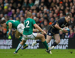 09.02.2013 Edinburgh, Scotland.   Scotland's Stuart Hogg on the attack , skips past Ireland's Luke Marshall during the RBS Six Nations Championship match between Scotland and Ireland, from Murrayfield Stadium.