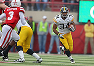 November 25, 2011: Iowa Hawkeyes running back Marcus Coker (34) on a run during the first half of the NCAA football game between the Iowa Hawkeyes and the Nebraska Cornhuskers at Memorial Stadium in Lincoln, Nebraska on Friday, November 25, 2011.