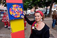 Roma 23 Maggio 2015<br /> La Campagna Slotmob contro la diffusione del gioco d'azzardo legalizzato a organizzata una marcia nel quartiere Tiburtino consegnando degli adesivi ai bar slot-free che hanno rinunciato agli introiti dell'azzardo per un puro gesto di responsabilità, e che sono stati premiati, con una colazione di massa,  dei partecipanti alla marcia. Giochi sani<br /> Rome May 23, 2015<br /> Campaign Slotmob against the spread of legalized gambling in a march organized in the district Tiburtino delivering stickers to bar slot-free that they gave up to the revenue of chance for a pure gesture of responsibility  and have been rewarded with a Breakfast mass of marchers.