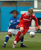 Photo: Tony Oudot.<br />Millwall v Nottingham Forest. Coca Cola League 1. 07/04/2007.<br />Kris Commons of Notts Forest goes around Richard Shaw of Millwall