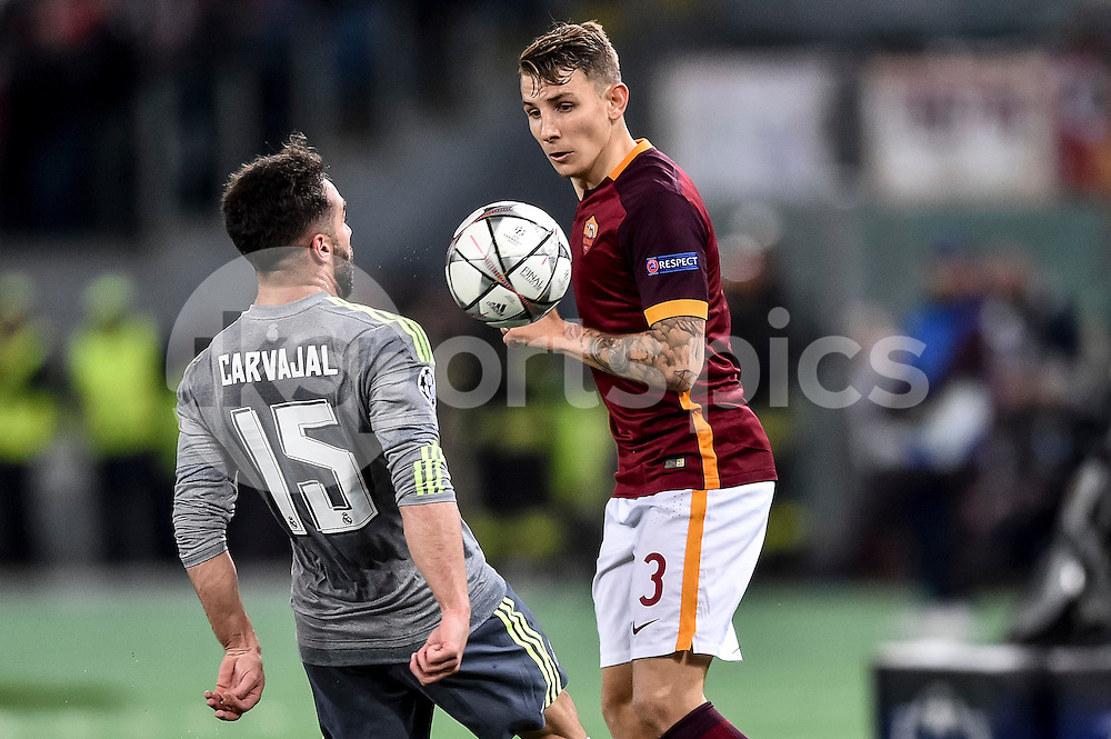 Lucas Digne of Roma and Dani Carvajal of Real Madrid fight for the ball during the UEFA Champions League match between Roma and Real Madrid at Stadio Olimpico, Rome, Italy on 17 February 2016. Photo by Giuseppe Maffia.