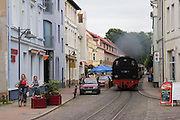 Molli, the famous steam train, leaves Bad Doberan through the middle of the city in direction of Kuehlungsborn, a beach town on the Baltic Sea.