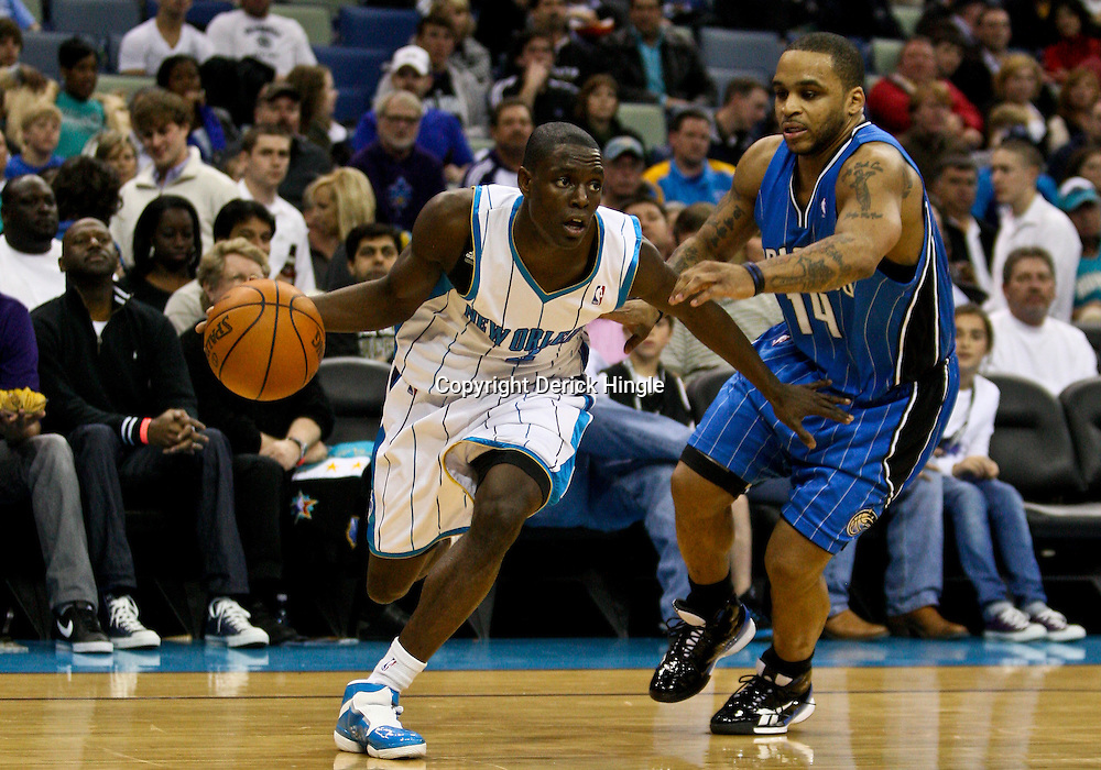 Feb 26, 2010; New Orleans, LA, USA; New Orleans Hornets guard Darren Collison (2) drives past Orlando Magic guard Jameer Nelson (14) during the second half at the New Orleans Arena. The Hornets defeated the Magic 100-93. Mandatory Credit: Derick E. Hingle-US PRESSWIRE
